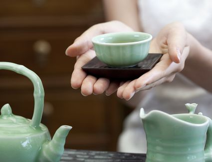 Young woman serving Chinese tea