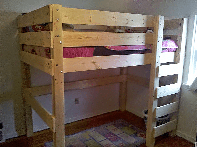 A Wooden Loft Bed With Ladder