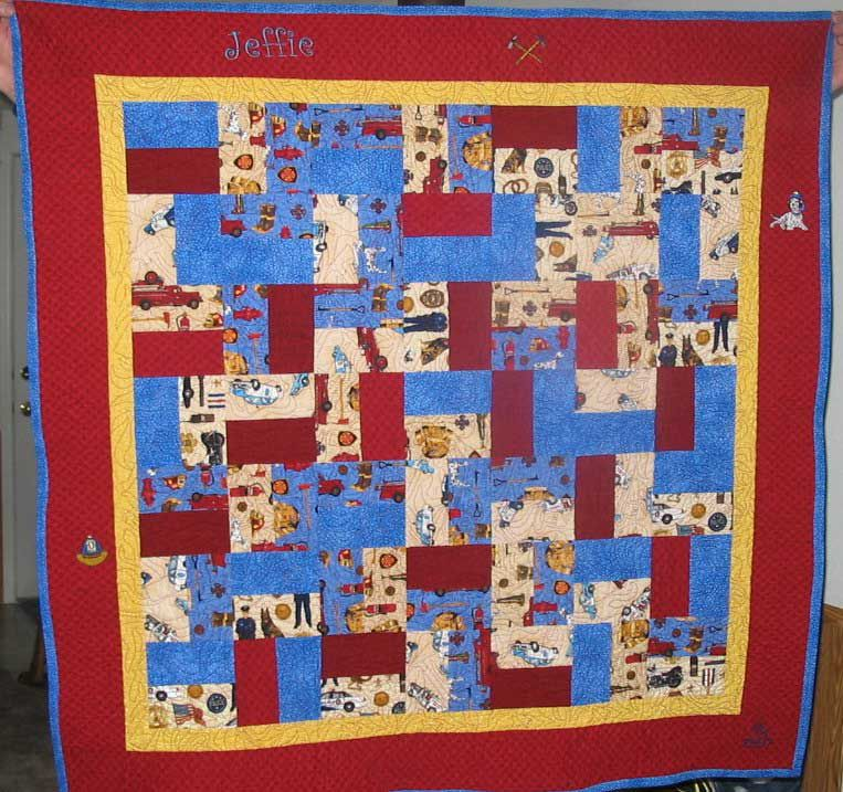Red and blue firefighter quilt with the name Jeffie on it.