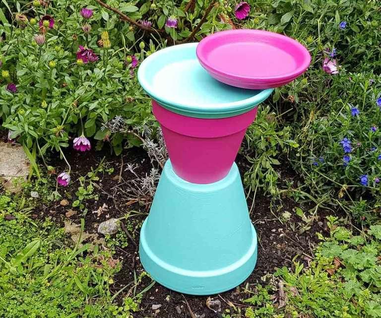 Color-blocked birdbath made of clay pots