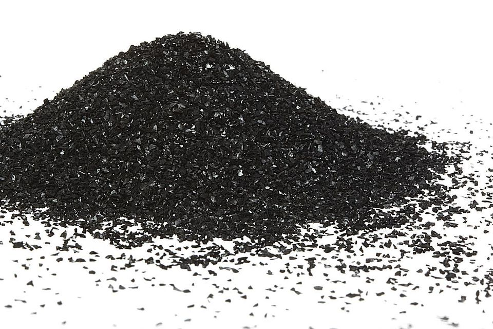 A mound of activated (or active) carbon powder (also called activated coal or charcoal) from a water filter.
