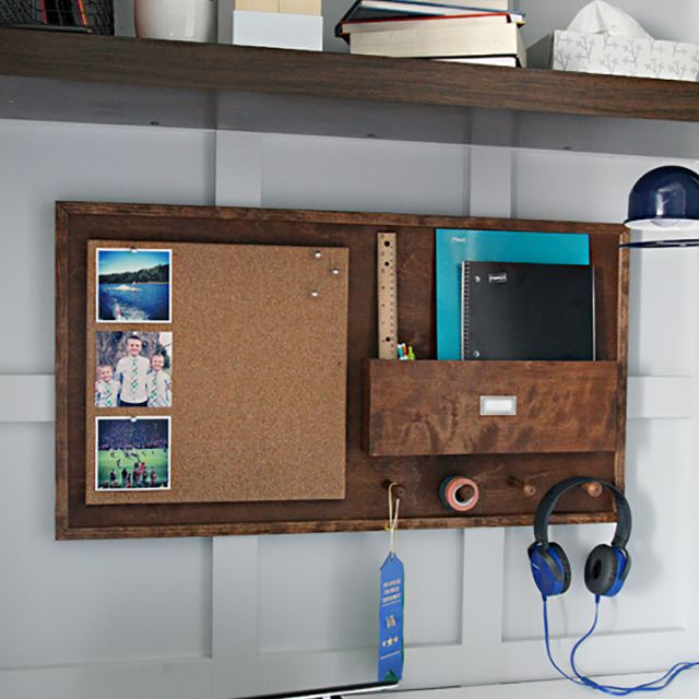Dark wooden wall desk organizer above a laptop