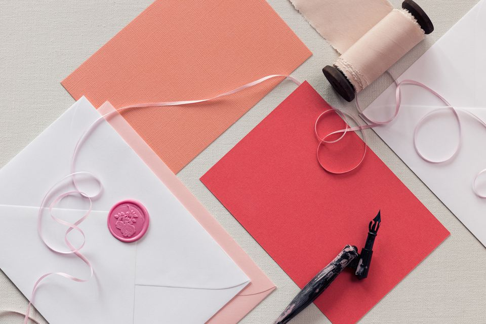 Top down view of blank pink thank you notes or wedding invitation.