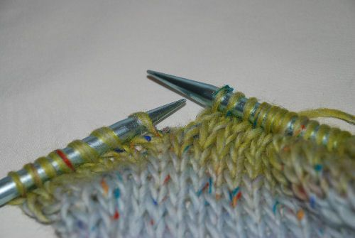 Knit to the dropped stitch.