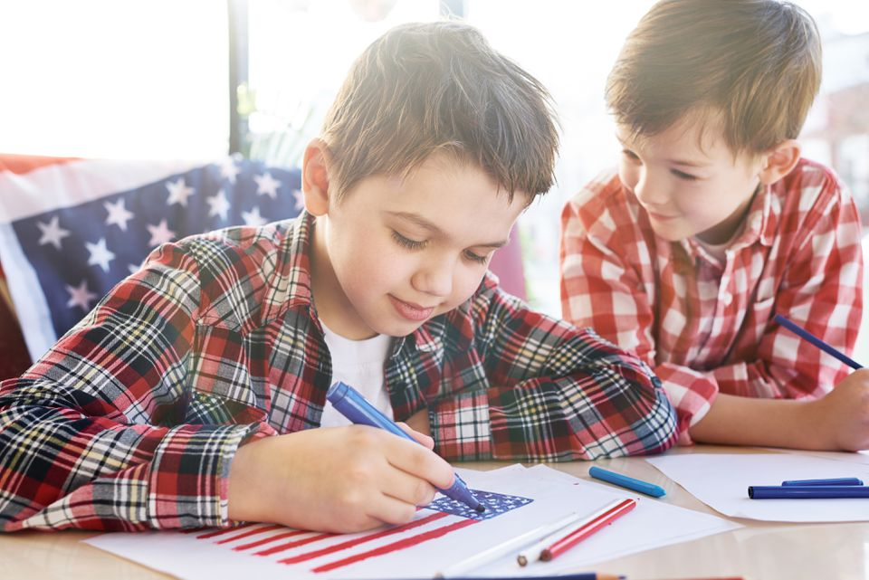 Boys coloring a an American flag