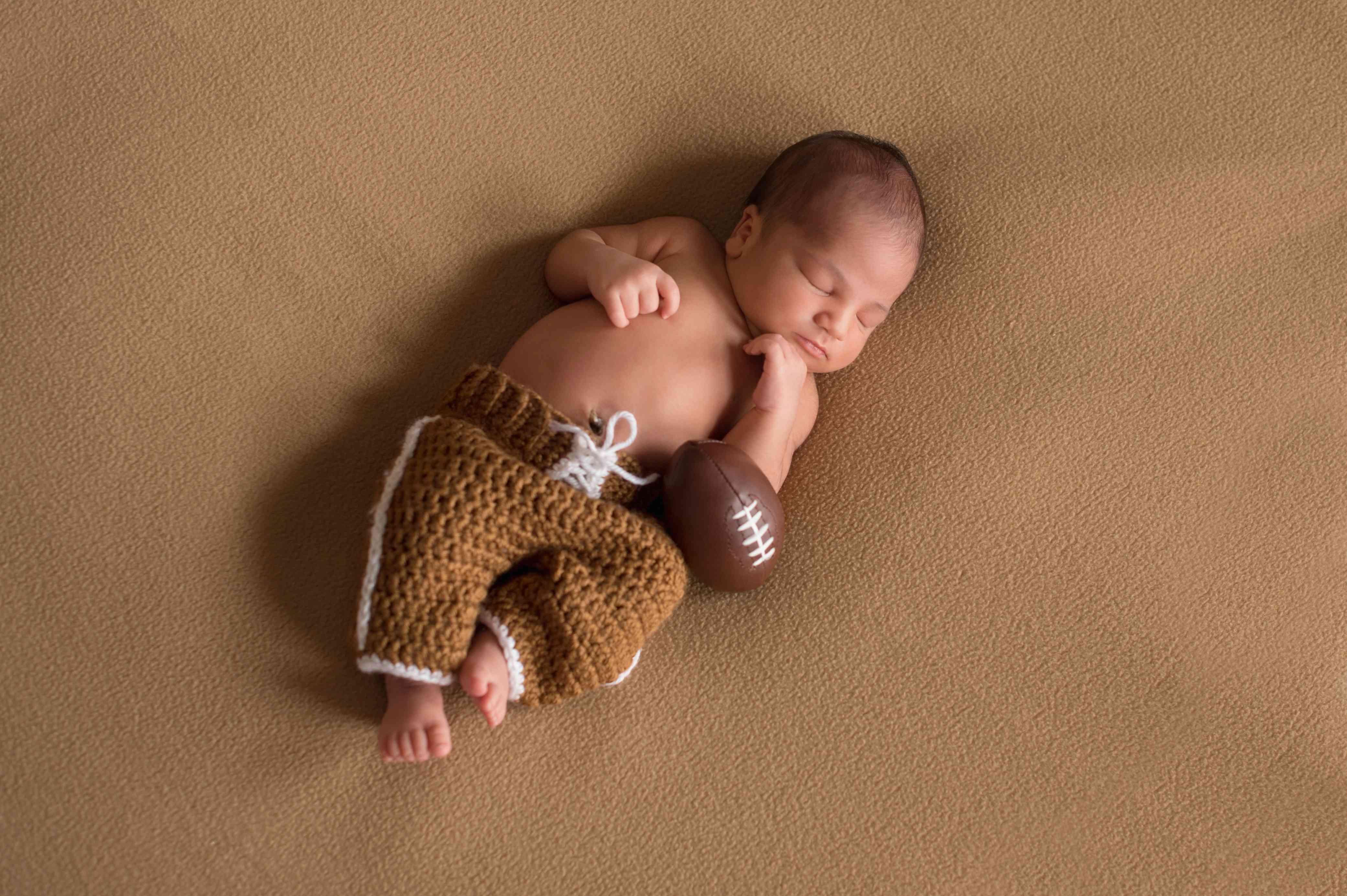 baby in crochet football pants
