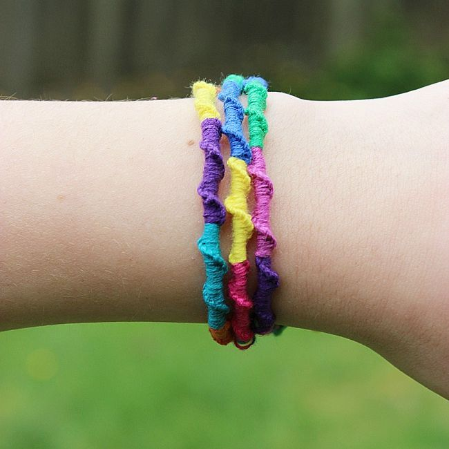 Three friendship bracelets on an arm