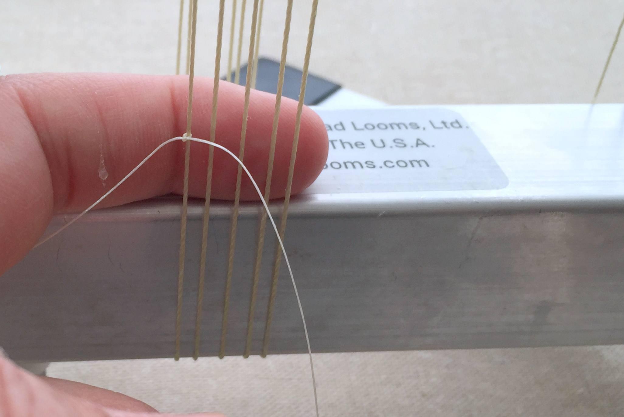 Attach weft thread