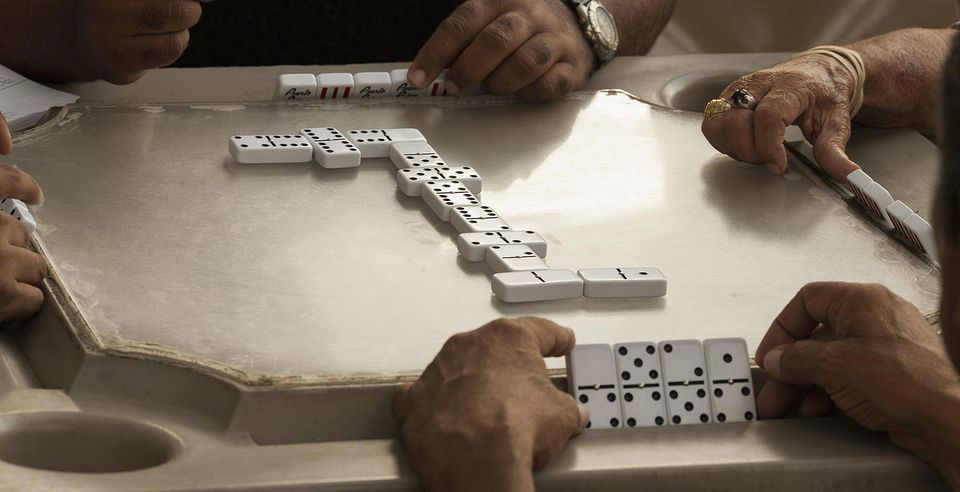 Men enjoying dominos
