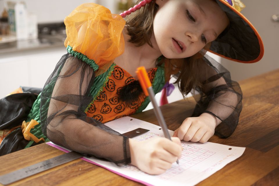 Girl studying in Halloween costume