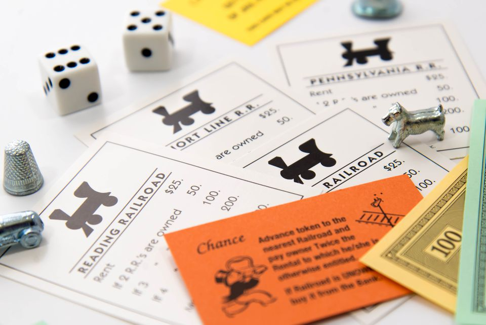 Monopoly - railroad cards, pieces, money and dice