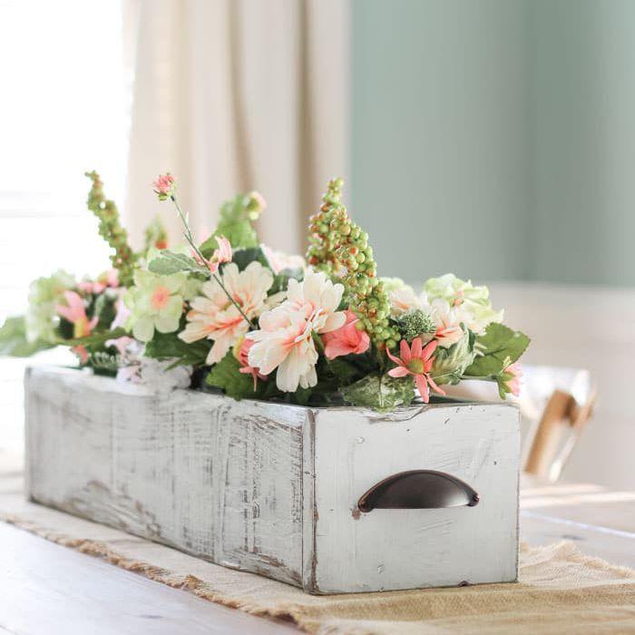 diy flower arrangement inside wood drawer