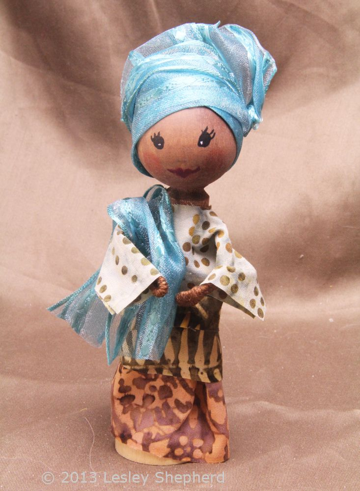 Clothespin doll in Nigerian style dress.
