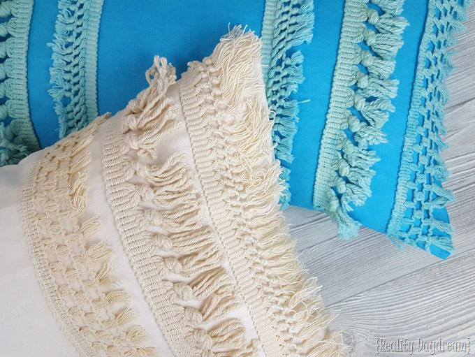 two macrame pillows on light gray background