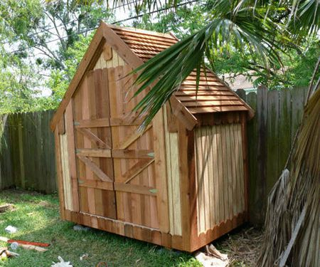 A narrow wooden shed in a backyard - 20 Free Shed Plans That Will Help You DIY A Shed