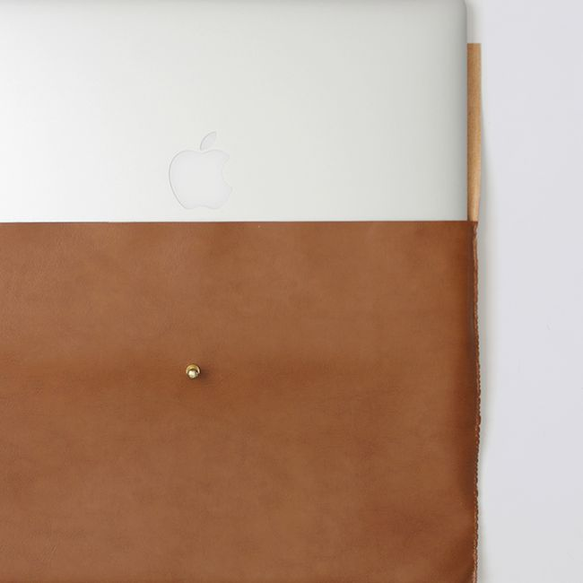 Leather laptop sleeve with a laptop in it