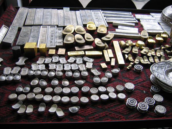 Counterfeit ingots and bars made by a major Chinese fake coin operation.
