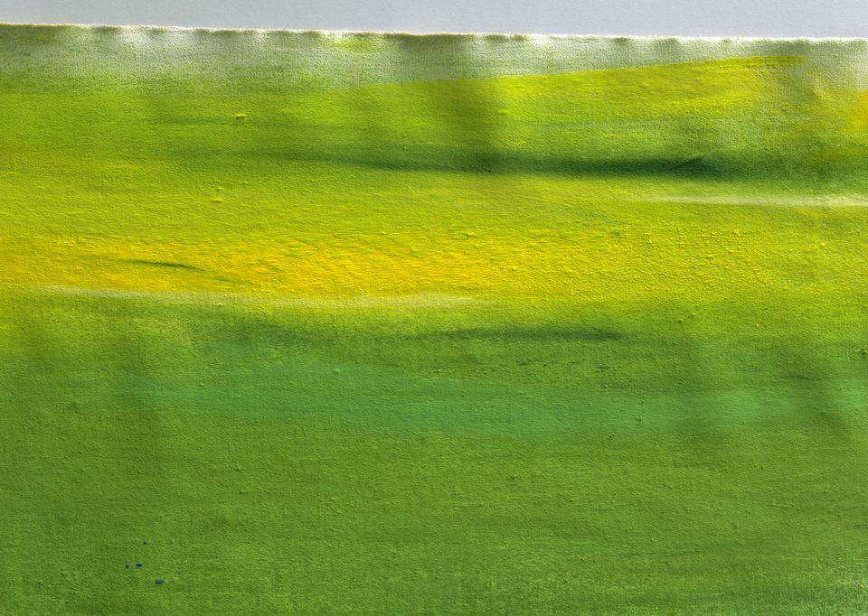 Yellow and green paint on fabric, full frame
