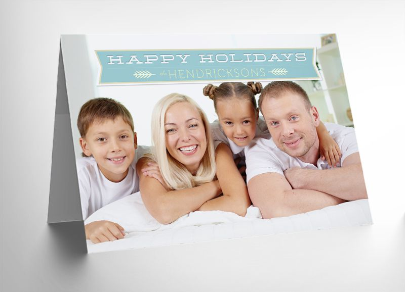 A mock-up of a folded Christmas photo card