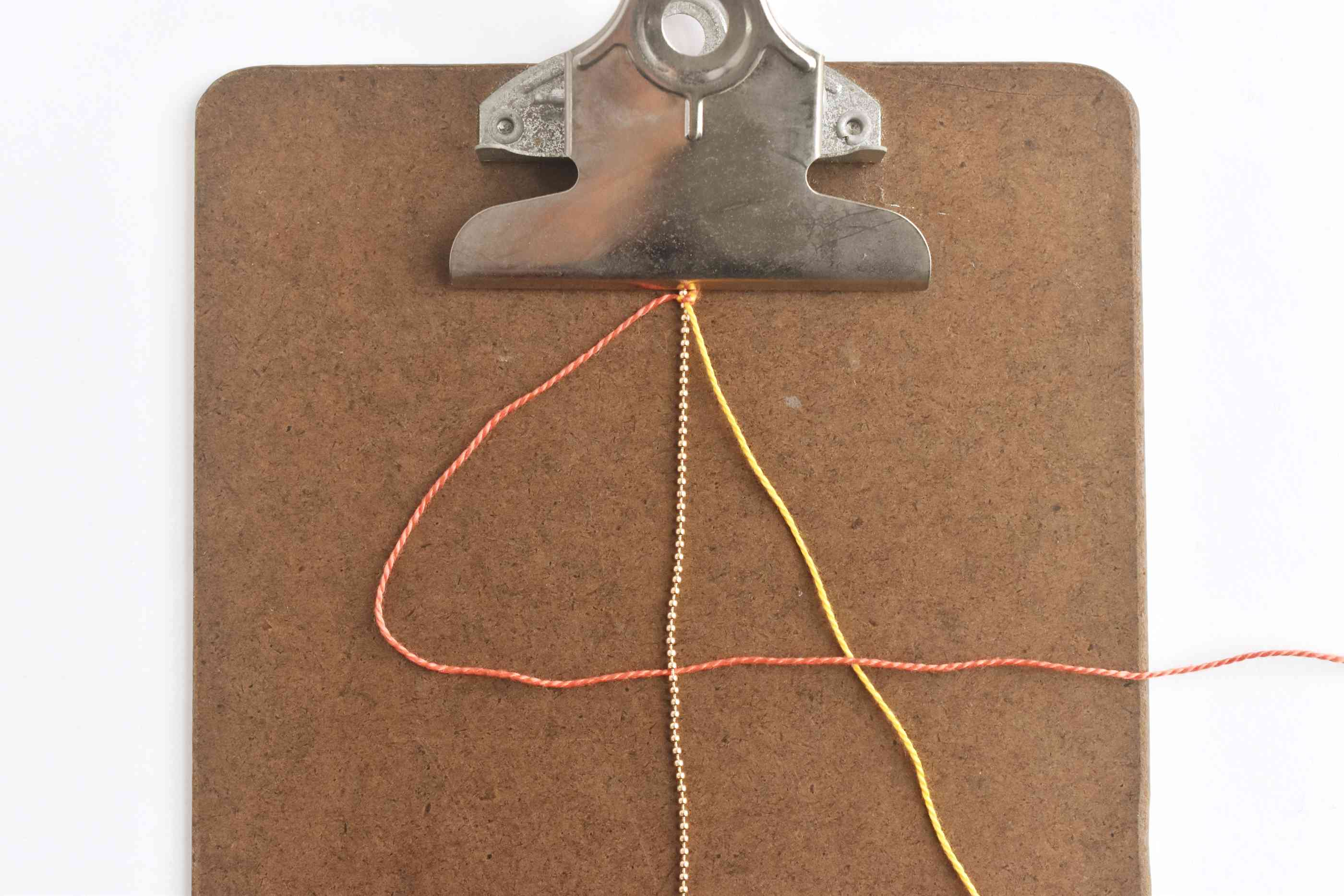 Place the Left Thread Behind the Chain and Over the Right Thread