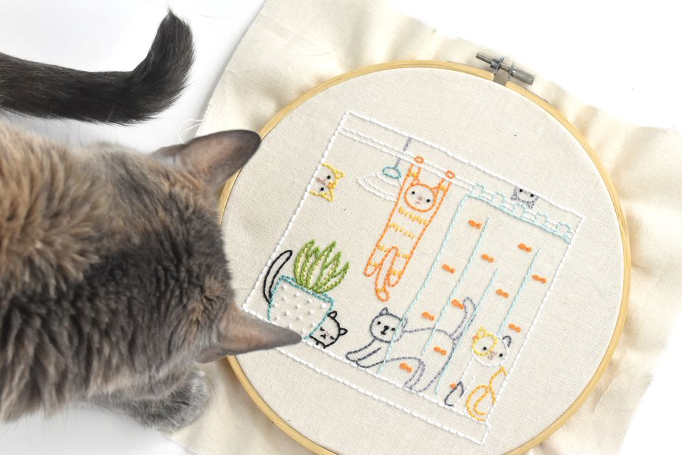 Playful Cats in the Window Free Embroidery Pattern