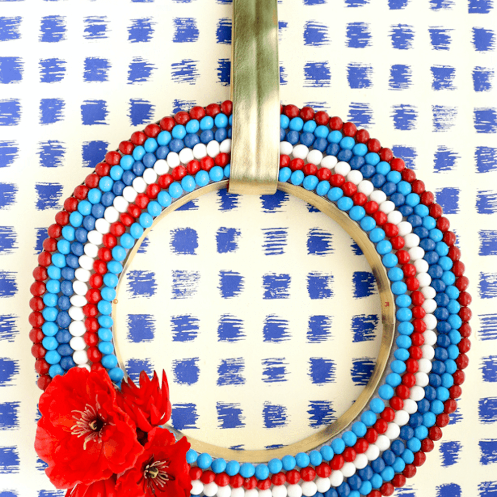 a red white and blue wreath made of skittles