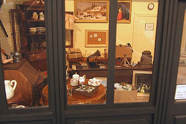 Interior of a classic antiques shop with collectibles and furniture.