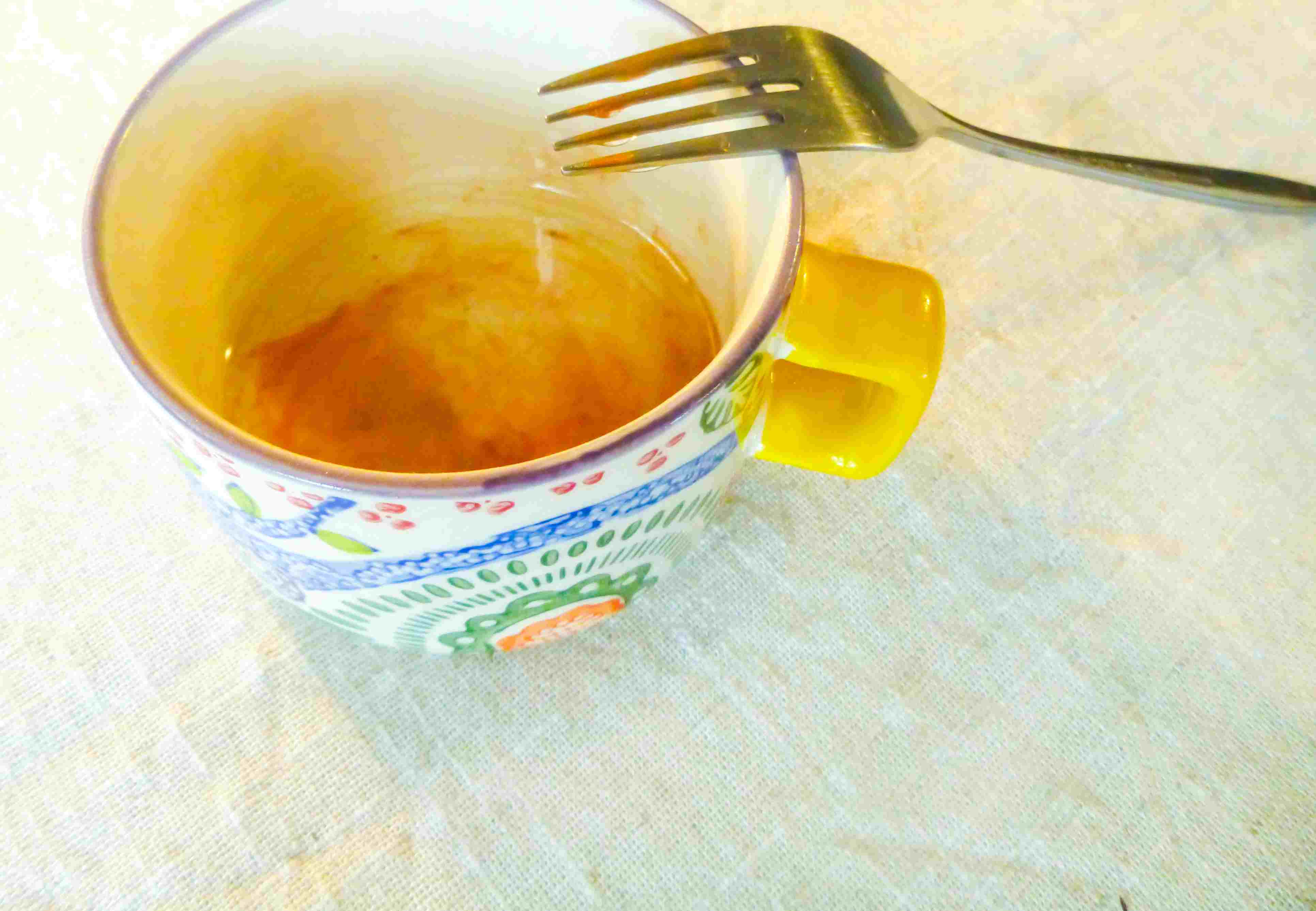 Melted micas with oil in a mug