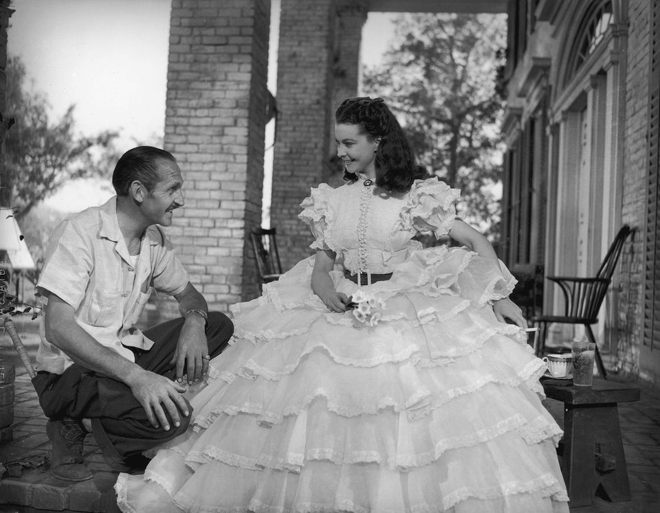 Walter Plunkett on the set with Vivien Leigh dressed as Scarlett O'Hara during the filming of Gone with the Wind.