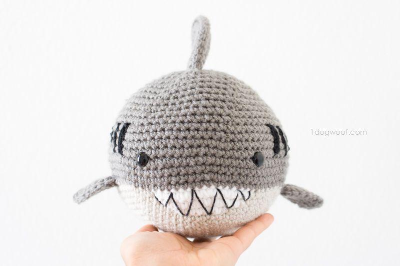 Grey crochet shark with big teeth.