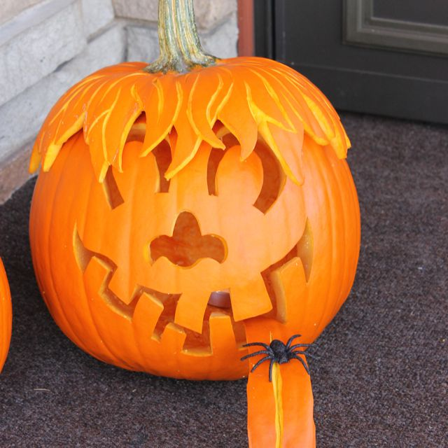 Pumpkin with hair and a tongue