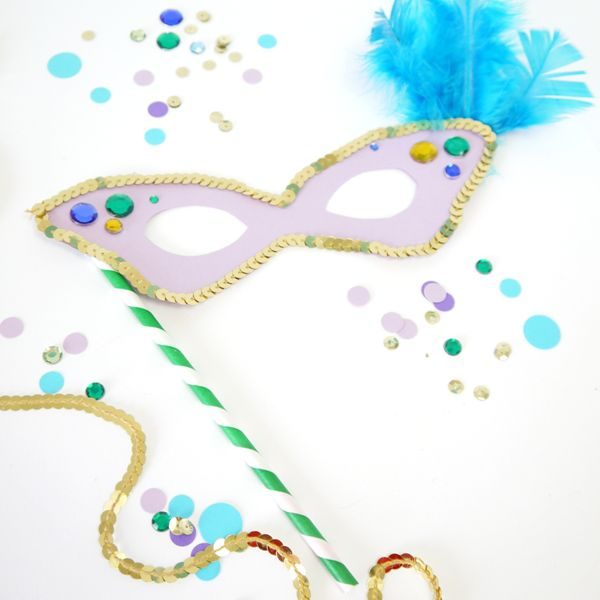 A Decorated Mardi Gras Mask Laying On Table