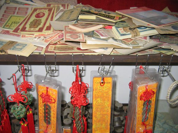 Counterfeit currency and tourist goods made by a major Chinese fake coin operation.
