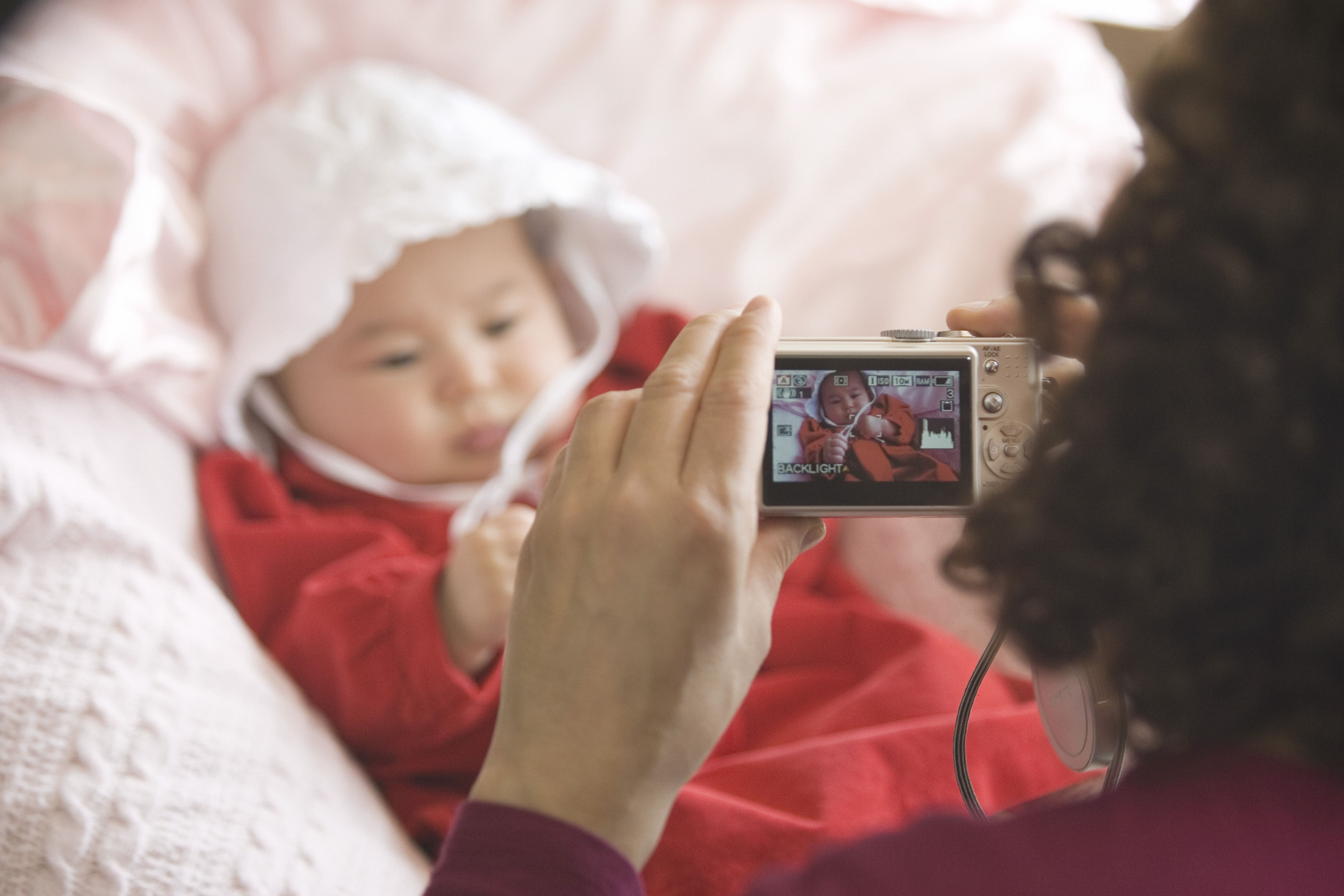 Mother taking a picture of baby girl