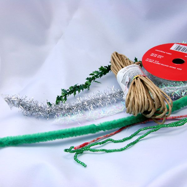Wired paper, ribbon, tinsel, fabric and artificial holly