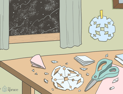 An illustration of paper snowflakes being cut out on a table with a winter night outside of the window