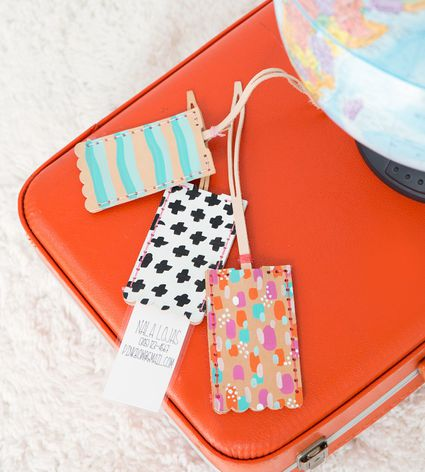 Painted leather luggage tags