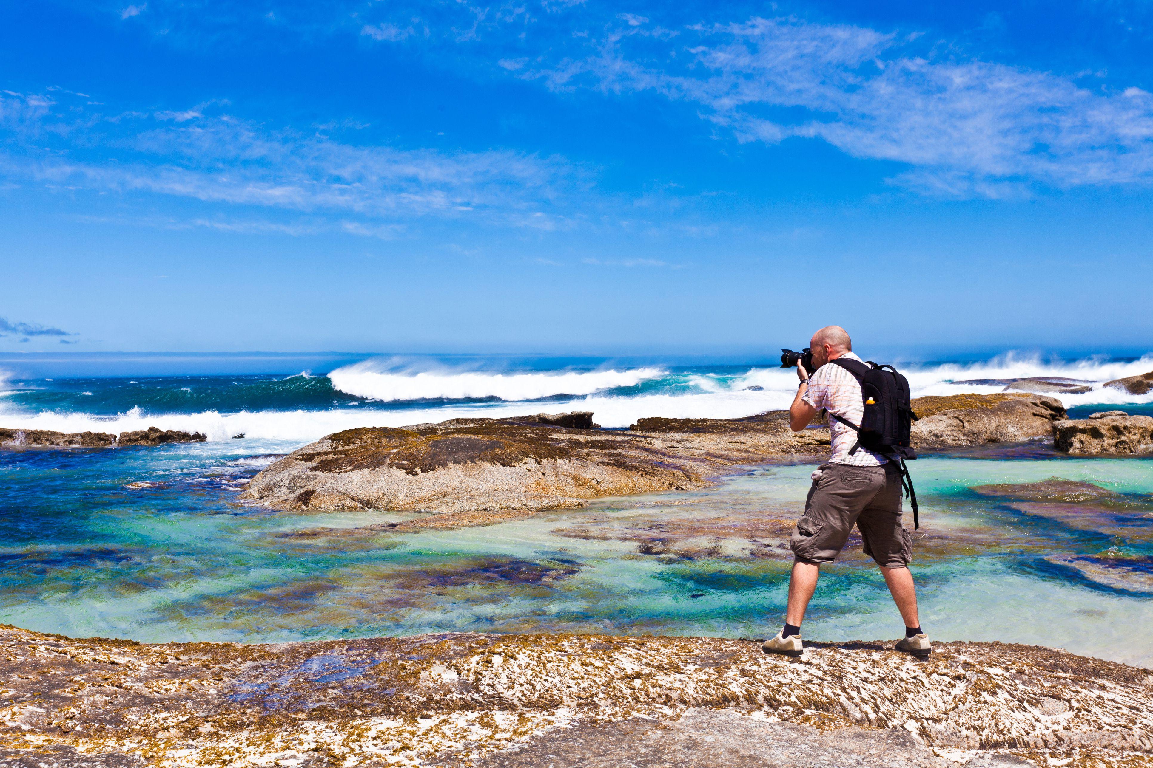 Photographer at coastline