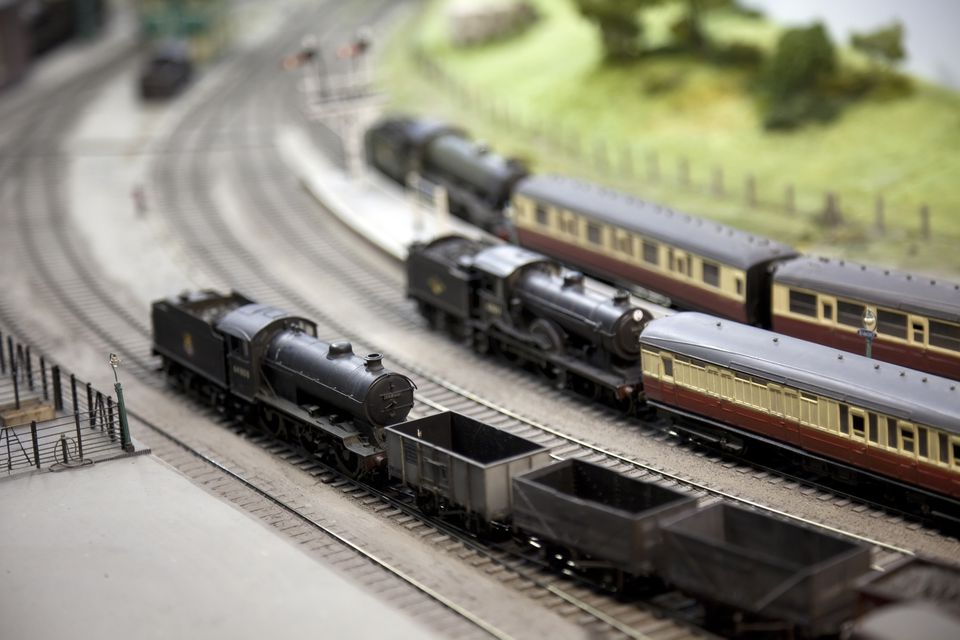 Model trains going around a track