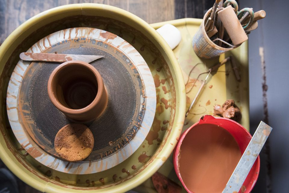 Cup and tools on pottery wheel