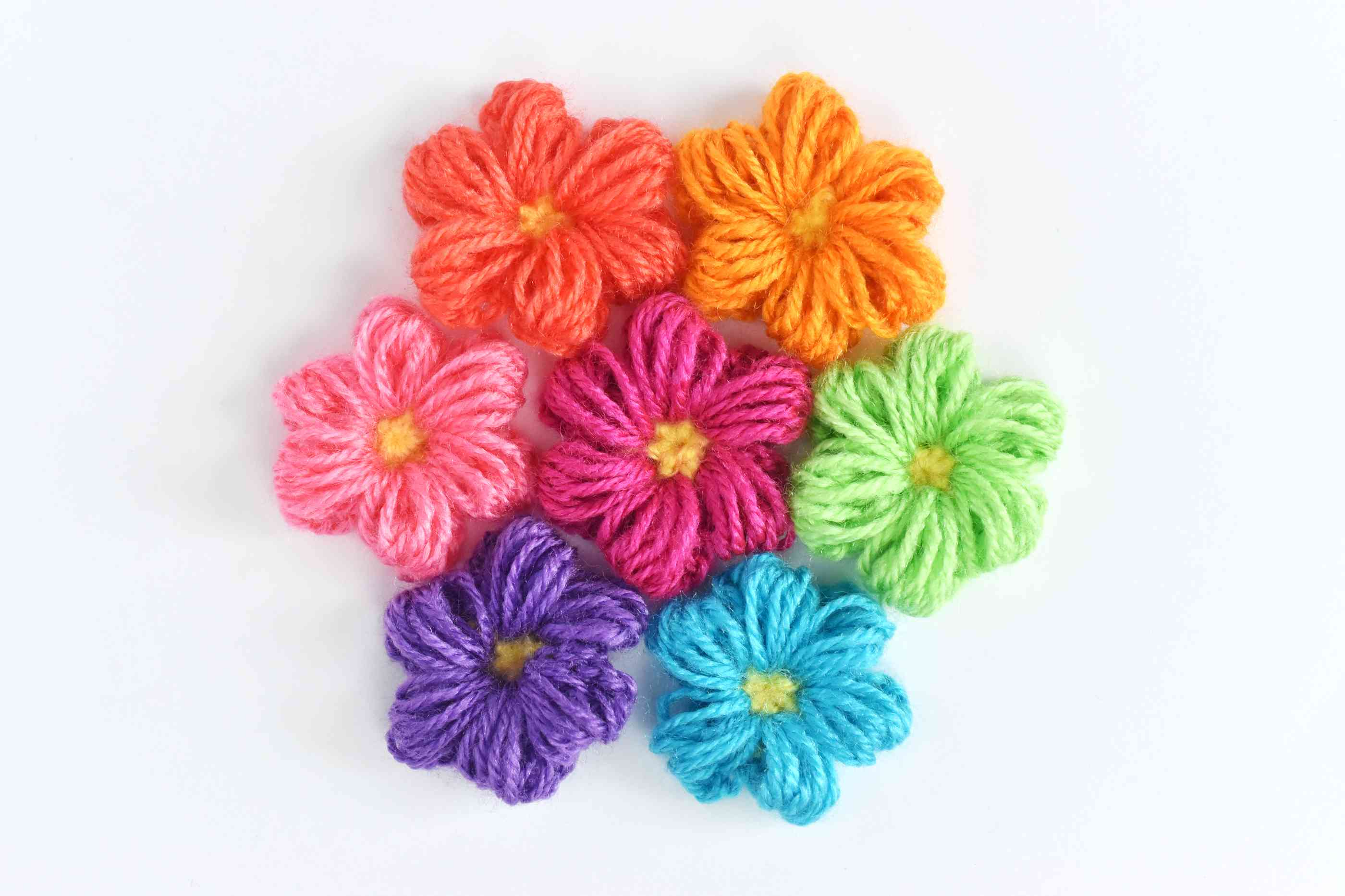 An assortment of colorful puff stitch crochet flowers
