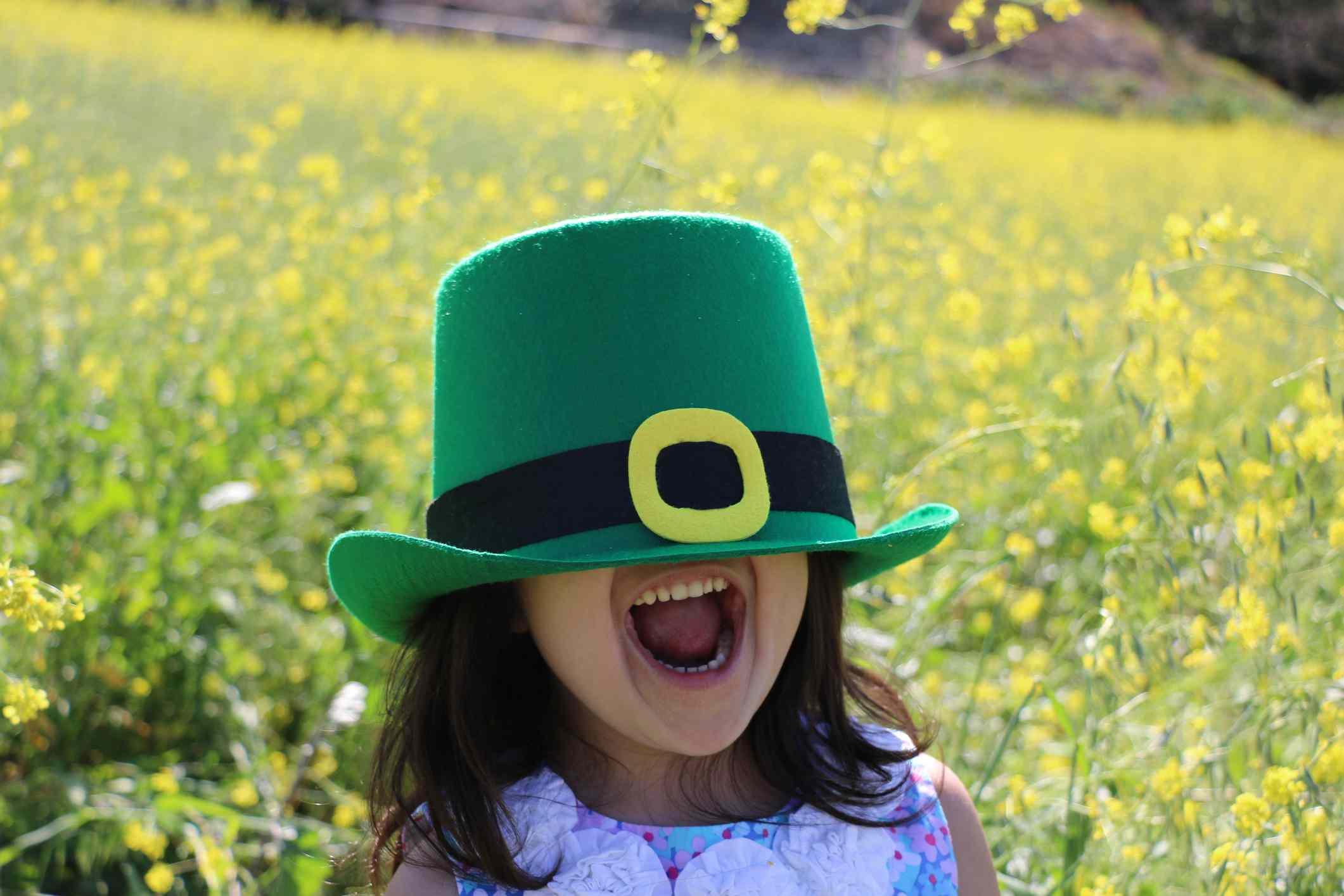 A little girl wearing a leprechaun hat