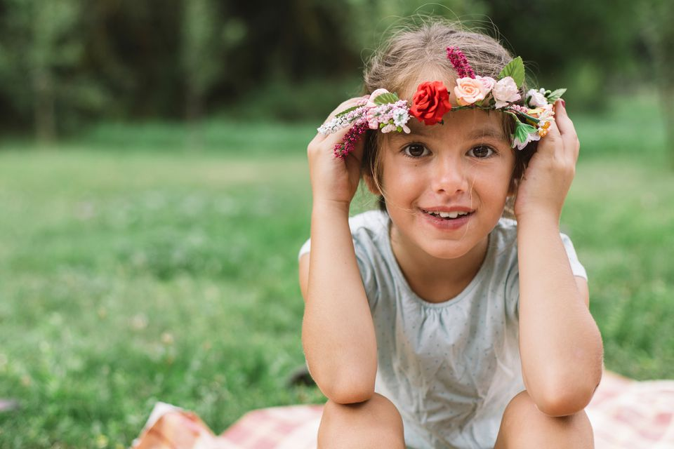 child with a flower wreath on her head