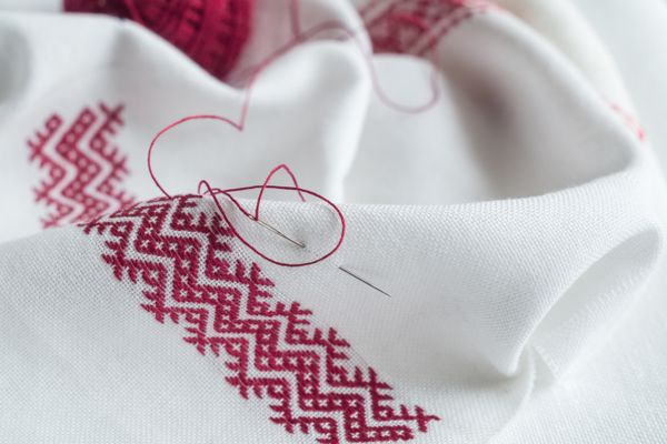 Fragment of hand embroidery