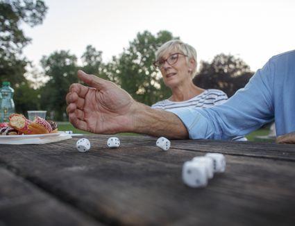 Senior people playing yacht game