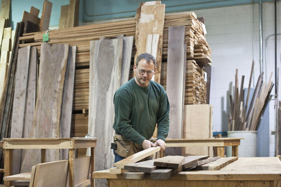 Man selects wood for a project
