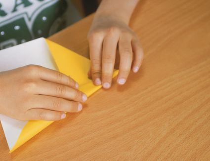 A child folding origami