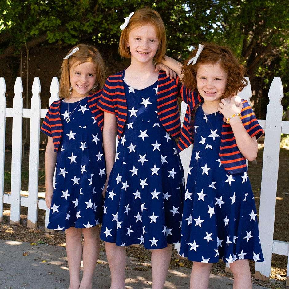 Three girls wearing matching outfits