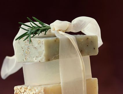 Wrapped bars of soap with fresh rosemary