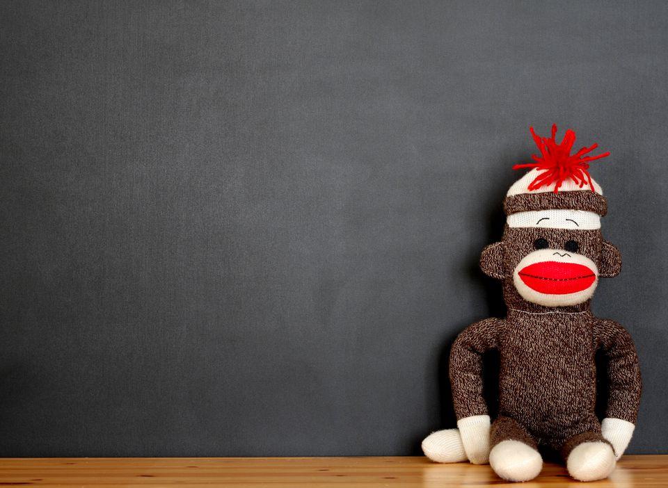 Sock Monkey in Front of Blackboard